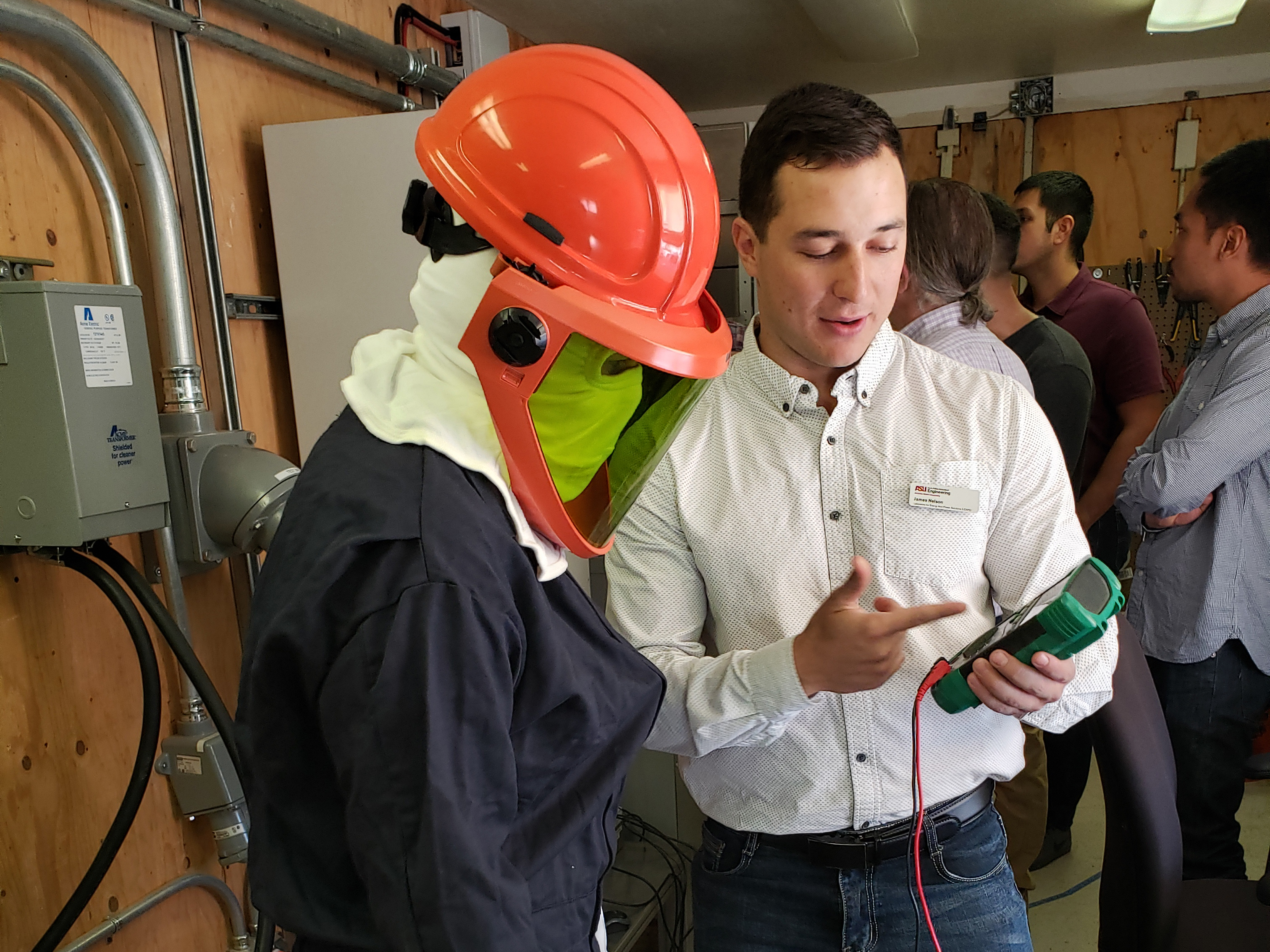 Image of instructor teaching a microgrid bootcamp attendee who is in protective gear.